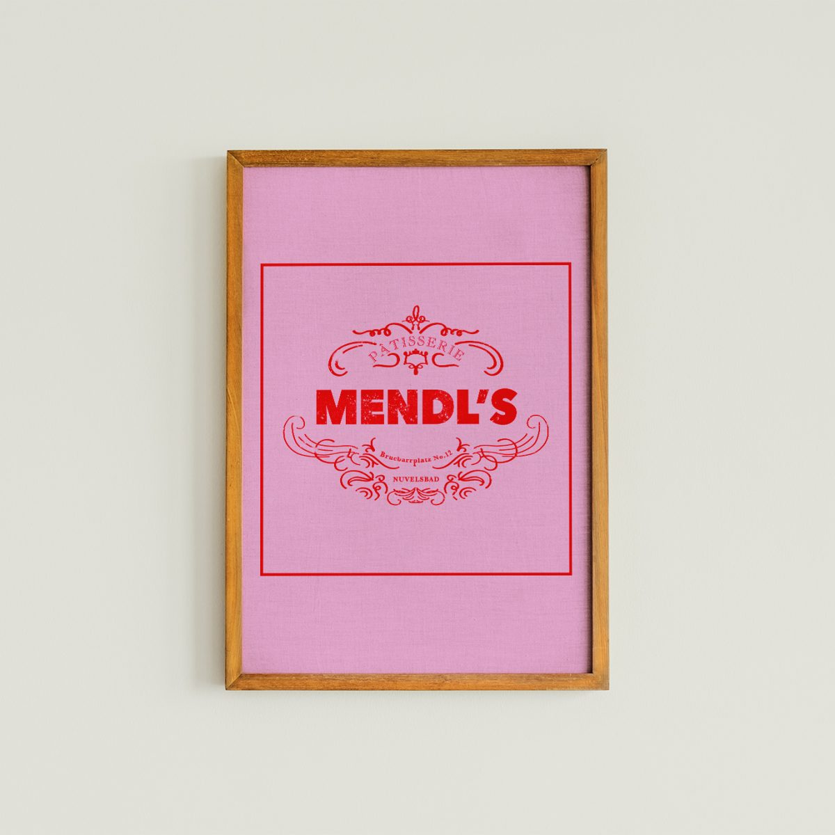 Pink Mendl's bakery box from Wed Anderson's Grand Budapest Hotel, Art print with a wooden frame